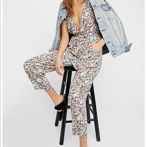 Free people ruffle your feathers printed jump suit